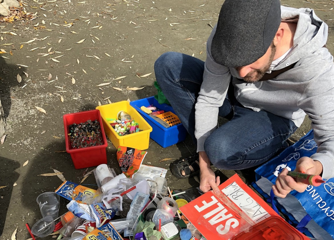 community member takes part in shoreline cleanup