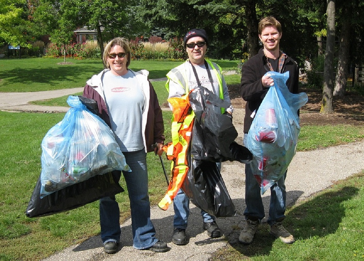 corporate team members take part in litter cleanup event